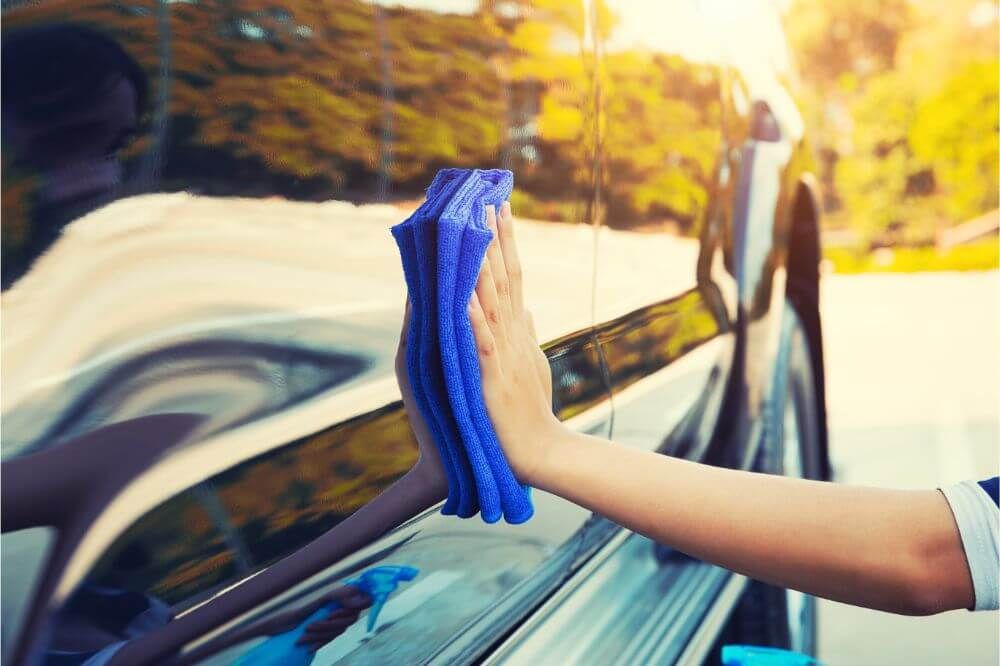 Best Swirl and Scratch Remover being used on a blue car hood