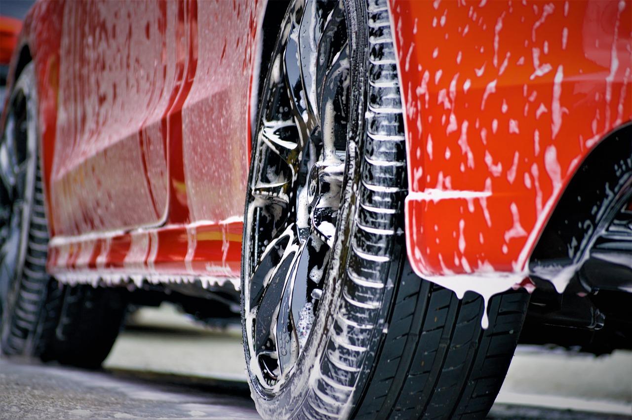 Snow foam running off car. to show washing before polishing