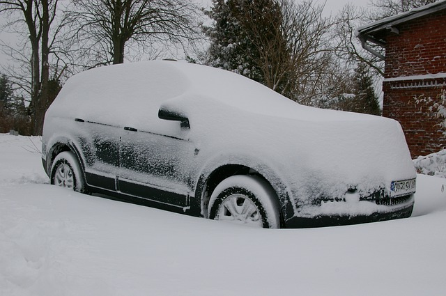 A car covered in snow to show how the winter elements can affect the bodywork