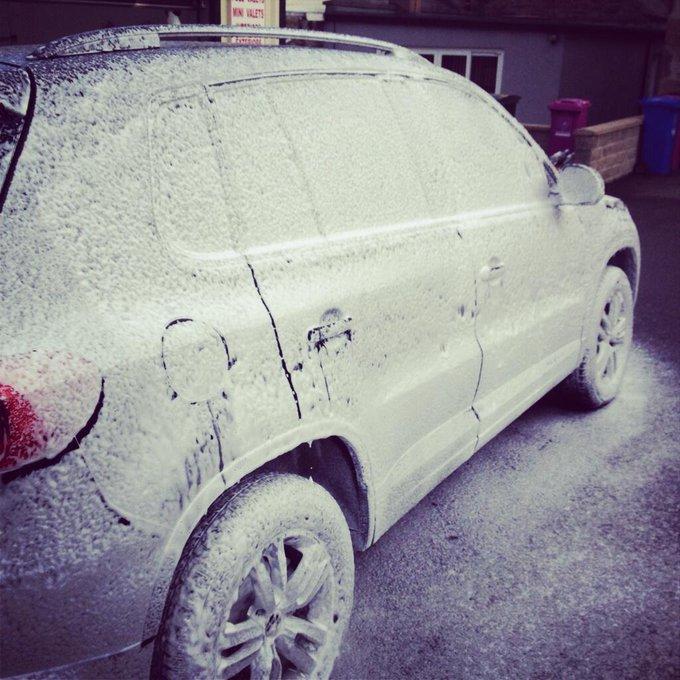 Snow Foam Car Wash covering a n SUV